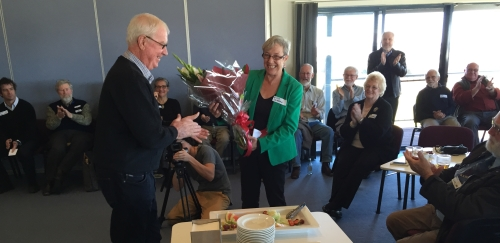 Prof Deirdre Lemerle being presented with a farewell gift of flowers