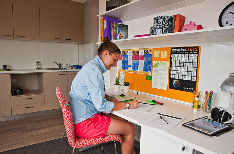 Student at her desk in her room