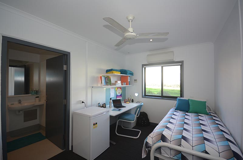 Wide view of room showing sleeping and study areas with ensuite to the side
