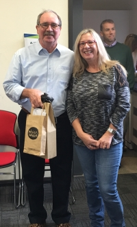 Graham Centre Office Manager Maree Crowley congratulating Professor Wade on his retirement.