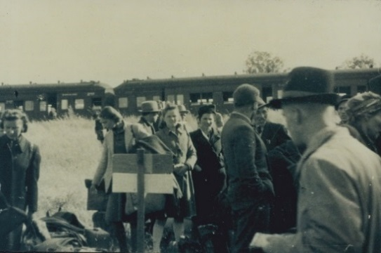 Archival photo of migrants arriving at the camp