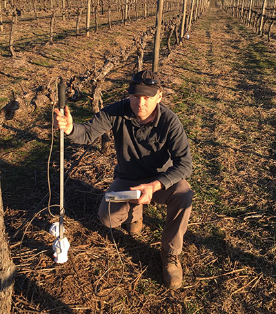 photo of  Dr Jason Smith  in the vineyard