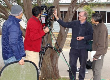 Photo of CSU academic Associate Professor Geoff Burrows (second from left) with NHK crew at CSU in Wagga Wagga.