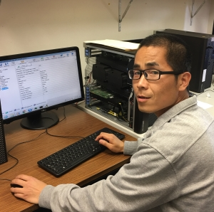 Photo: Associate Professor Xiaojun Shen is using the APSIM-WHEAT model to simulate grain yield and water use efficiency of wheat under different irrigation treatments.