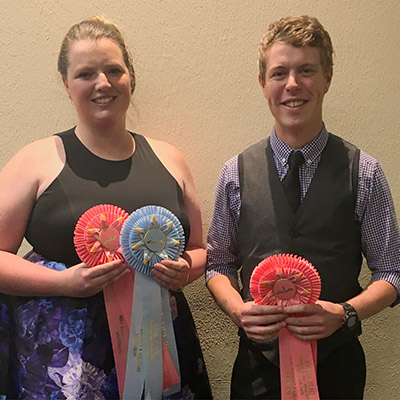 Kate webster and Harry Meek with awards from meat judging competitions