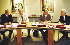 (left to right) Mark Burdack, Director of the Office of Vice-Chancellor, Deputy Chancellor Ian Macintosh AM, Chancellor Lawrie Willett AO, and Vice-Chancellor Professor Ian Goulter.