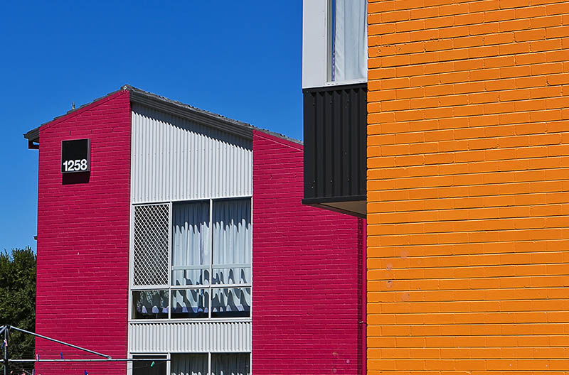 Exterior view of the brightly coloured buildings