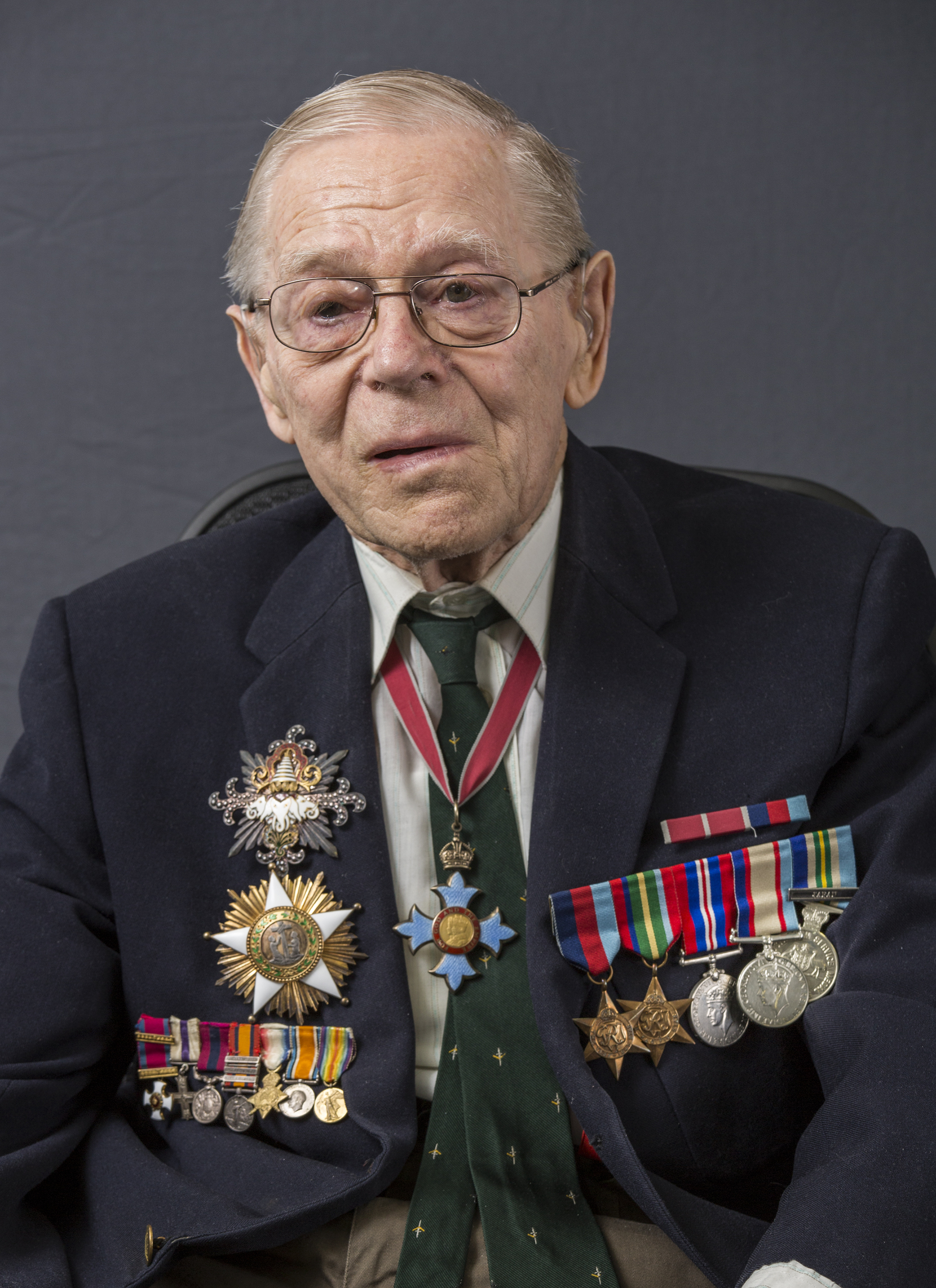 Barrie Dexter wearing awards and medals