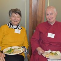 Chaplain Debbie Mazlin and Tempa Bejanke enjoy lunch. Photograph by Sarah Stitt