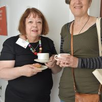 Two attendees enjoy morning tea at Old Parliament House. Photograph by Sarah Stitt