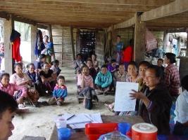 Women farmers presenting farmer case studies to their village