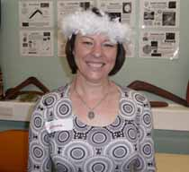 Professor Sharynne McLeod wearing a traditional Wiradjuri headdress made by her language teacher Ms Diane McNaboe.