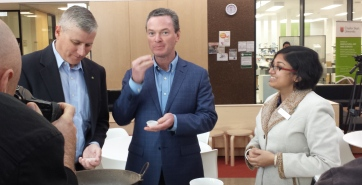 Member for Riverina, the Hon. Michael McCormack MP, Education Minister the Hon Christopher Pyne MP and CSU student Mrs Soumi Paul Mukhopadhyay tasting chickpeas at CSU