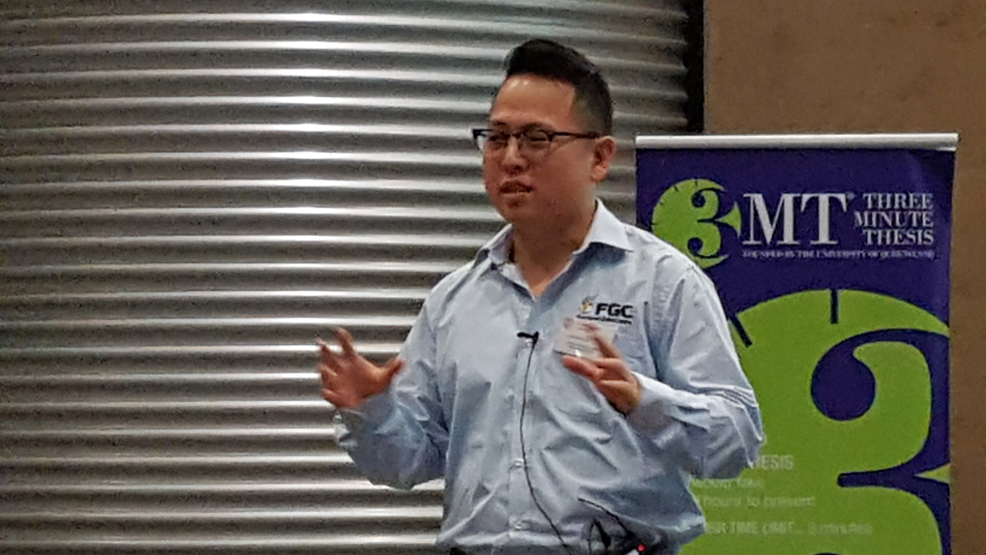 James Lee presenting at the 3MT