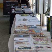The stalls for Little Lost Bookshop and the ACC&C in the foyer. Photograph by Sarah Stitt