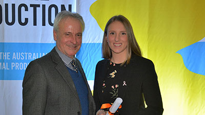 Photo of Cara Wilson receiving her award