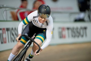 Kaarle McCulloch racing on a bicycle