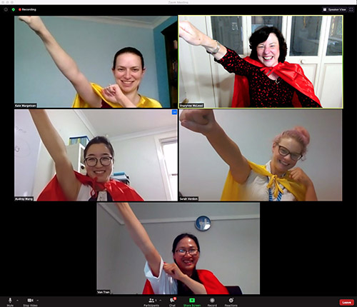 screenshots of videoscreens of the VietSpeech team delivering SuperSpeech in super hero capes