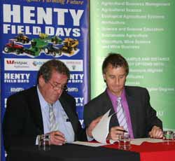 Henty Machinery Field Day Chairman Mr Ross Edwards and Dean of the University's Faculty of Science Professor Nick Klomp check their signatures on the MoU.