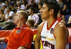 Dr Stephen Bird and Damian Martin of the Perth Wildcats during the semi-final win against the Wollongong Hawks.