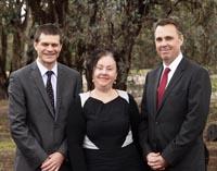 CSU VC Professor Andrew Vann (left) and La Trobe VC Professor John Dewar (right) with MDMS director Dr Kim Webber.