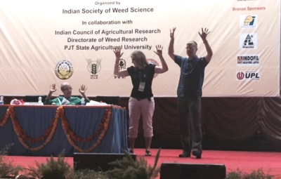 Graham Centre Industry Partnerships and Communications Manager, Toni Nugent and Professor Deirdre Lemerle assist Dr Michael Widderick, Queensland Department of Agriculture and Fisheries, Toowoomba, explain weed seed harvest methods at the 25th Asian-Pacific Weeds Conference, Hyderabad, India. style=
