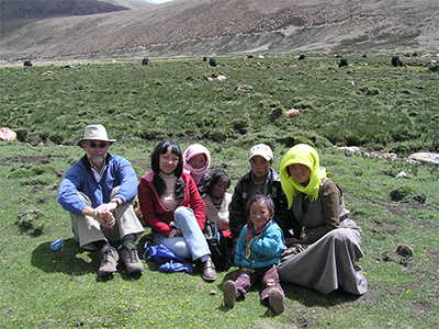 photo of Professor Kemp and Dr Pematso discussing issues with Tibetan herders near Namshto lake (5500m) on the Tibetan Plateau as part of Dr Pematso's PhD in Anthropology.