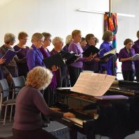 A Chorus of Women performed at the Welcome Reception. Photograph by Katherine Waite
