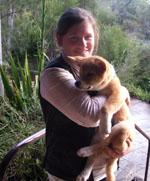 Ms Emma Dunston with a dingo pup