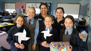 photo of Functional Grains Centre PhD students Ms Esther Callcott and Ms Michelle Toutounji with Mater Dei primary school students Claudia Hamilton, Elisa Cook, Lilly McGowan and Charlotte Simpson with their experiments.