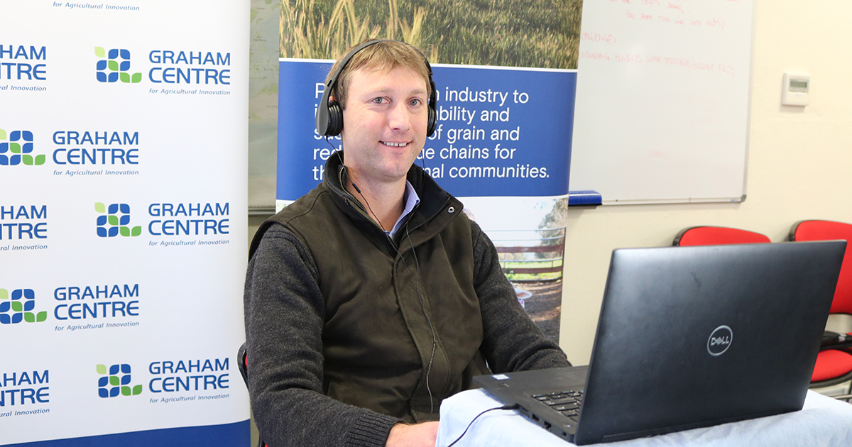 Dr Shawn McGrath at a computer