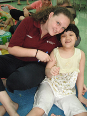 CSU physio student Ms Grace Pitts with an orphan in Vietnam