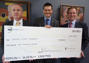 CSU Vice-Chancellor Professor Andrew Vann receives a sponsorship cheque from SGE's Mr Michael Reid (left) and Mr Michael Coburn (right).