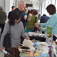 Attendees persuse the books at the Little Lost Bookshop stall. Photograph by Sarah Stitt