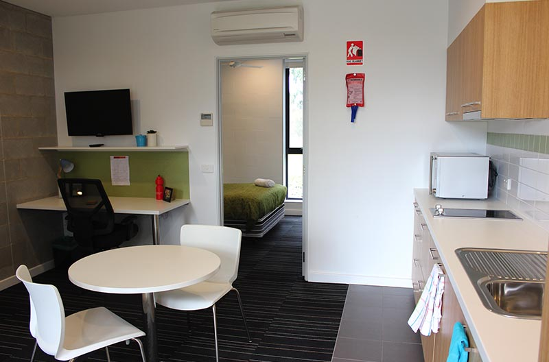 Wide view showing kitchen, lounge and study areas, through to the sleeping space