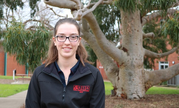 Graduating student's research asks: Is it worth processing barley when feed lotting lambs?