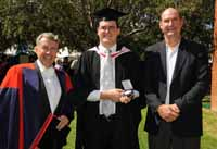 CSU's Dr Graeme McLean with one of his former students and winner of the CSU Medal Mr Aidan Luke at the CSU graduation on Thursday 2 April 2009. Mr Luke was accompanied by his father Rodney Luke from Canberra.
