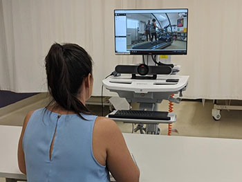A medical practitioner overseeing a Telehealth video conference