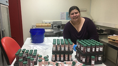 PhD student Bridgette Logan with samples to be analysed